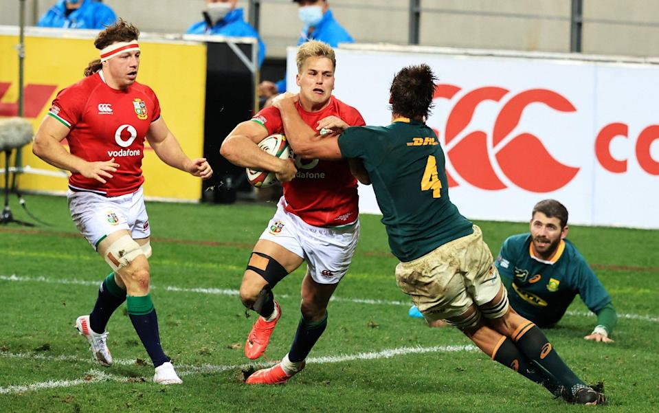 Duhan Van Der Merwe of British & Irish Lions is tackled short of the line by Eben Etzebeth of South Africa during the 1st Test between South Africa & British & Irish Lions at Cape Town Stadium on July 24, 2021 in Cape Town, South Africa. - GETTY IMAGES