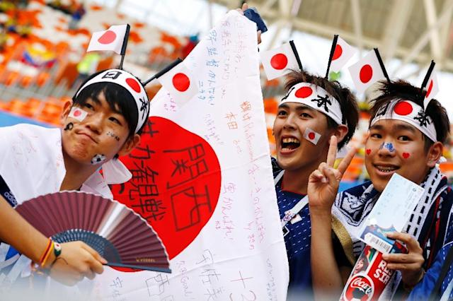 Japan fans' conduct in Russia worthy of world champions (AFP Photo/Jack GUEZ)