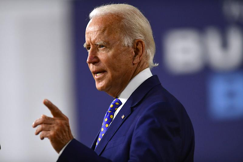 Former Vice President Joe Biden's massive ad blitz aims to present him to voters as a unifying leader equipped to steer the country through crisis. (Photo: Mark Makela/Getty Images)