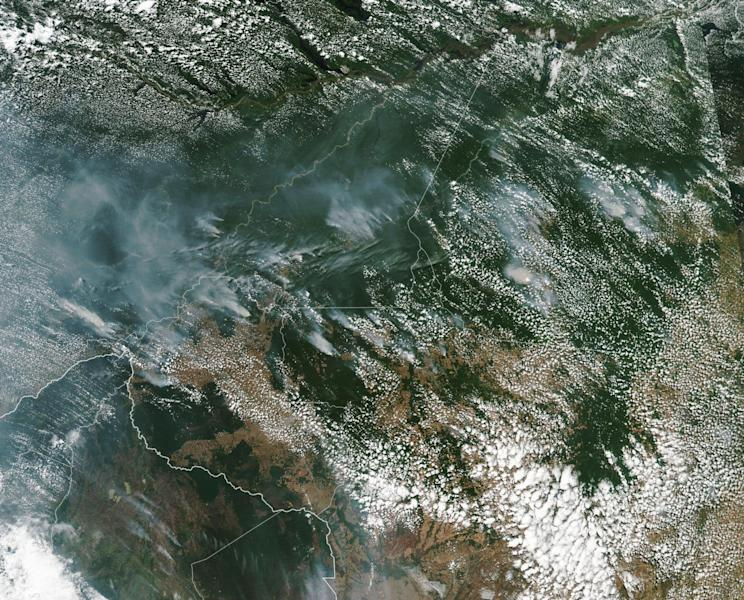 This satellite image provided by NASA on Aug. 13, 2019 shows several fires burning in the Brazilian Amazon forest. Brazil's National Institute for Space Research, a federal agency monitoring deforestation and wildfires, said the country has seen a record number of wildfires this year, counting 74,155 as of Tuesday, Aug. 20, an 84 percent increase compared to the same period last year. (NASA via AP)