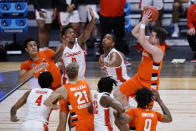 Syracuse guard Joseph Girard III (11) shoots against Houston in the first half of a Sweet 16 game in the NCAA men's college basketball tournament at Hinkle Fieldhouse in Indianapolis, Saturday, March 27, 2021. (AP Photo/AJ Mast)