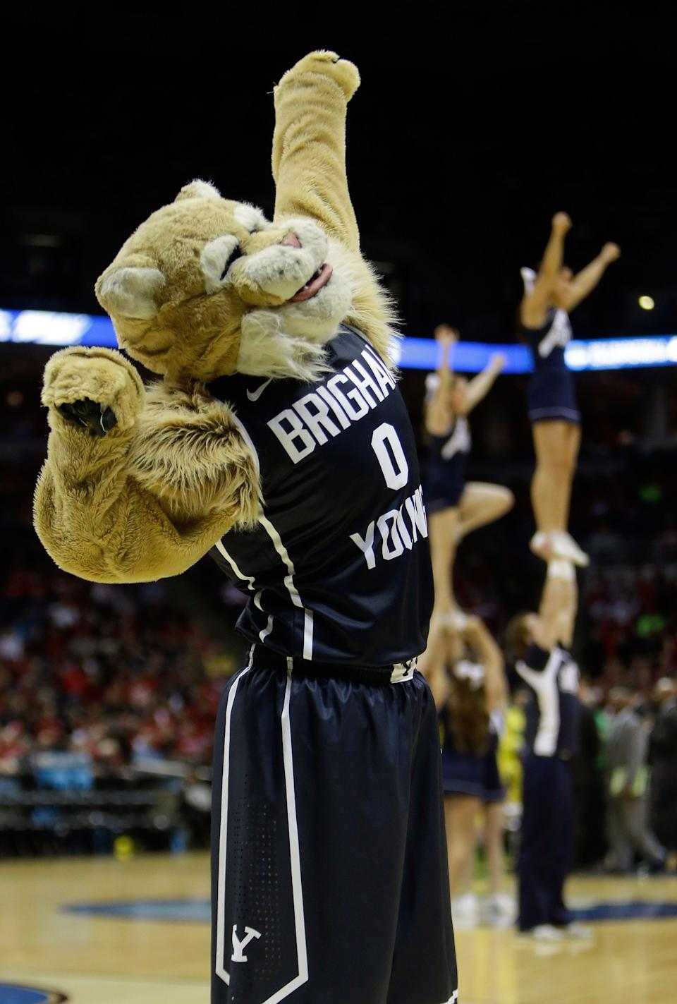 MILWAUKEE, WI - MARCH 20:  Brigham Young Cougars mascot Cosmo the Cougar performs during the second round game of the NCAA Basketball Tournament against the Oregon Ducks at BMO Harris Bradley Center on March 20, 2014 in Milwaukee, Wisconsin.  (Photo by Mike McGinnis/Getty Images)