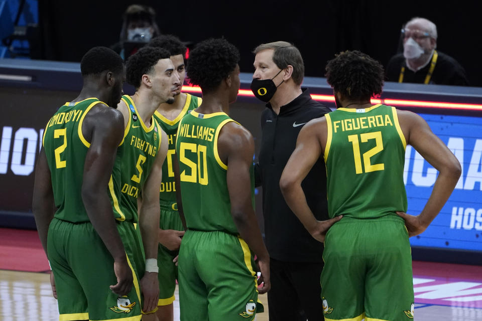 Oregon head coach Dana Altman talks during a timeout the first half of a men's college basketball game against Iowa in the second round of the NCAA tournament at Bankers Life Fieldhouse in Indianapolis, Monday, March 22, 2021. (AP Photo/Paul Sancya)
