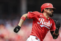 Cincinnati Reds' Nick Castellanos runs the bases after hitting a double during the third inning of a baseball game against the Colorado Rockies in Cincinnati, Sunday, June 13, 2021. (AP Photo/Aaron Doster)