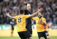 Wolverhampton Wanderers' Ruben Neves, left and Joao Moutinho, right, appeal to referee Anthony Taylor, during the English Premier League soccer match between Wolverhampton Wanderers and Aston Villa, at Molineux, in Wolverhampton, England, Sunday, Nov. 10, 2019. (Nick Potts/PA via AP)