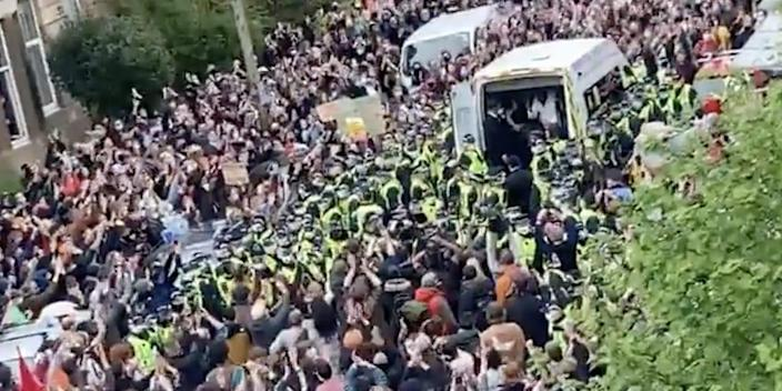 Crowds in Glasgow cheer after two men are released from an immigration enforcement van, Thursday 13 May.