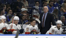 Florida Panthers coach Joel Quenneville stands behind players during the first period of the team's NHL hockey game against the Tampa Bay Lightning on Thursday, Oct. 3, 2019, in Tampa, Fla. (AP Photo/Chris O'Meara)