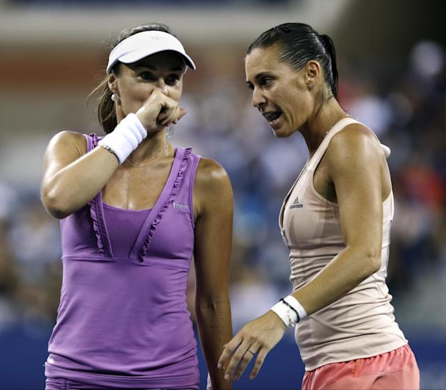 Martina Hingis, and Flavia Pennetta discuss strategy during the U.S. Open women's doubles final. They lost in three sets. (AP Photo/Charles Krupa)