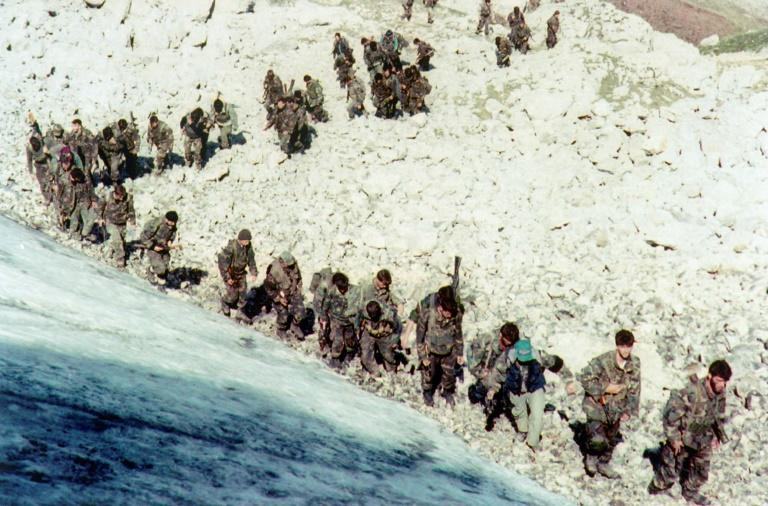 Bosnian army troops are seen walking up a hill near the city of Visoko, in 1995