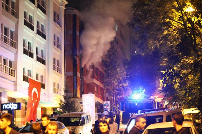 Smoke rises from the Pro-Kurdish People's Democratic Party (HDP) headquarters after an attack in Ankara on September 8, 2015 (AFP Photo/Adem Altan)