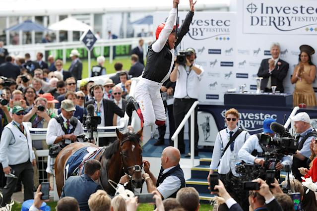 Horse Racing - Derby Festival - Epsom Downs Racecourse, Epsom, Britain - June 1, 2018 Frankie Dettori celebrates as he jumps off Cracksman after winning the 3.10 Investec Coronation Cup REUTERS/Peter Nicholls