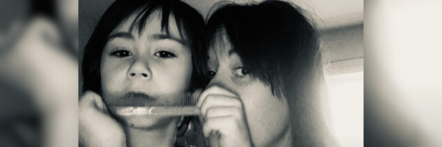 Jodie with her son Sam, who is playing with a comb.