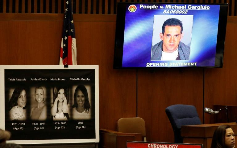 Photos of the victims are displayed in court during opening statements at the trial of Michael Gargiulo, pictured on the screen, who was found guilty in the killings of two women and faces a possible death sentence (AFP Photo/Al SEIB)