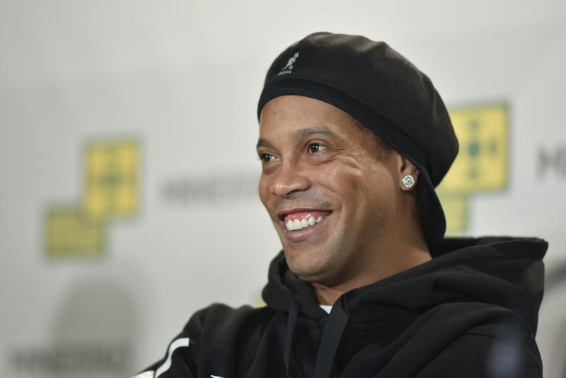 Brazilian former footballer Ronaldinho Gaucho attends a press conference during a ceremony to stamp his footprints at the Mineirao Stadium's football museum in Belo Horizonte, Minas Gerais state, Brazil, on May 21, 2018. - Ronaldinho Gaucho was awarded Best FIFA Men's Player twice, in 2004 and 2005. (Photo by DOUGLAS MAGNO / AFP) (Photo credit should read DOUGLAS MAGNO/AFP/Getty Images)