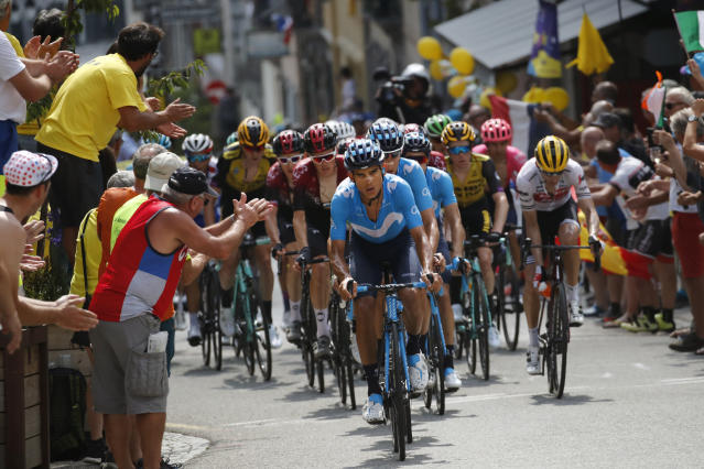 Spain's Mikel Landa, center, leads the breakaway group as he climbs the Tourmalet pass during the fourteenth stage of the Tour de France cycling race over 117.5 kilometers (73 miles) with start in Tarbes and finish at the Tourmalet pass, France, Saturday, July 20, 2019. (AP Photo/ Christophe Ena)