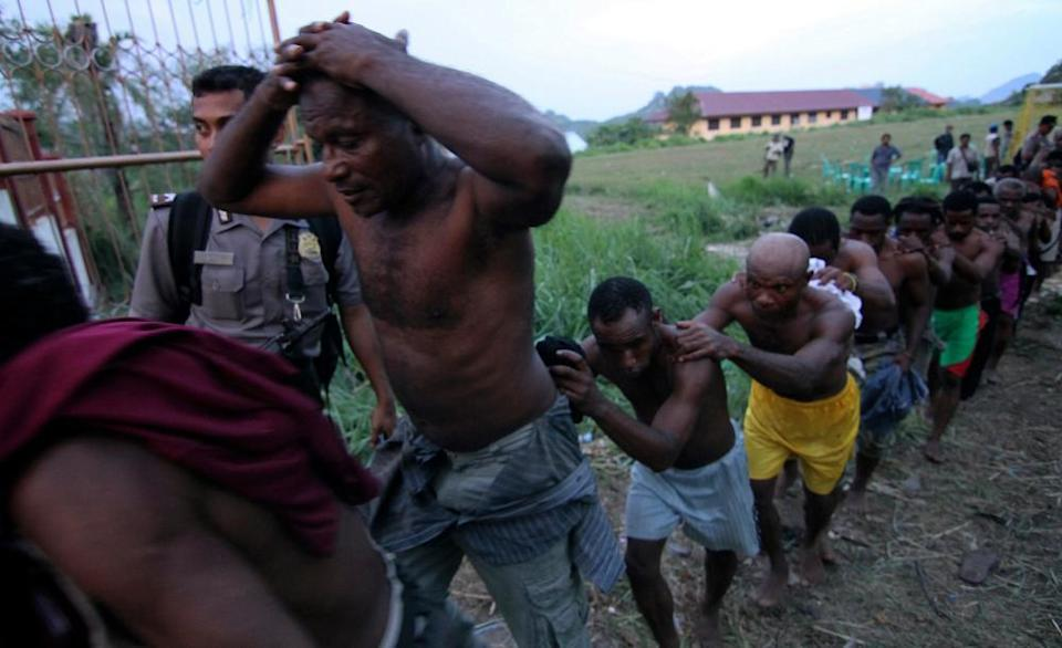 Police arrest attendees of the Third Papuan People's Congress in Abepura in Papua province in 2011.