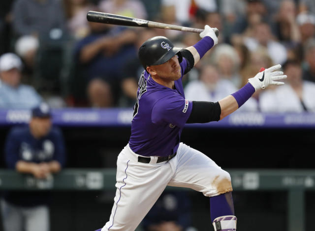 Colorado Rockies' Trevor Story watches his two-run home run off San Diego Padres starting pitcher Matt Strahm during the second inning of a baseball game Thursday, June 13, 2019, in Denver. (AP Photo/David Zalubowski)