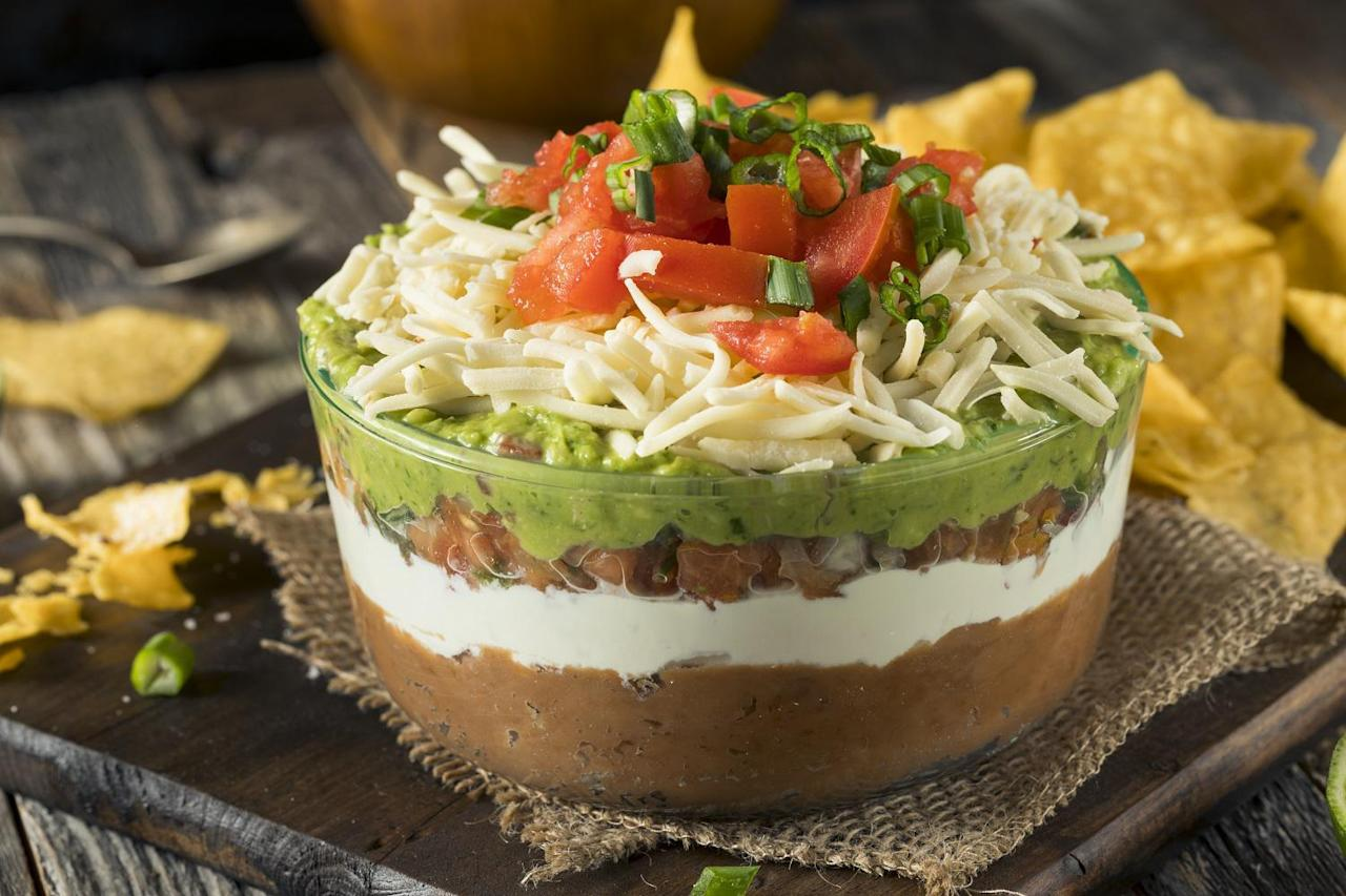 """<p>Though maybe best known as one of <a href=""""https://www.thedailymeal.com/entertain/most-popular-super-bowl-party-foods-ranked-slideshow?referrer=yahoo&category=beauty_food&include_utm=1&utm_medium=referral&utm_source=yahoo&utm_campaign=feed"""">the best Super Bowl party foods</a>, seven-layer dip (you know, the one with refried beans, sour cream, avocado, tomatoes, cheese, black olives and scallions) is great for any occasion.</p> <p><a href=""""https://www.thedailymeal.com/easy-7-layer-dip-recipe?referrer=yahoo&category=beauty_food&include_utm=1&utm_medium=referral&utm_source=yahoo&utm_campaign=feed"""">For the Easy Seven-Layer Dip recipe, click here.</a></p>"""