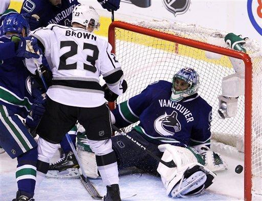 Los Angeles Kings right wing Dustin Brown (23) watches his third goal of the night go past Vancouver Canucks goalie Roberto Luongo (1) during third period of game two of first round NHL Stanley Cup playoff hockey action at Rogers Arena in Vancouver, British Columbia, Friday, April, 13, 2012. (AP Photo/The Canadian Press, Jonathan Hayward)