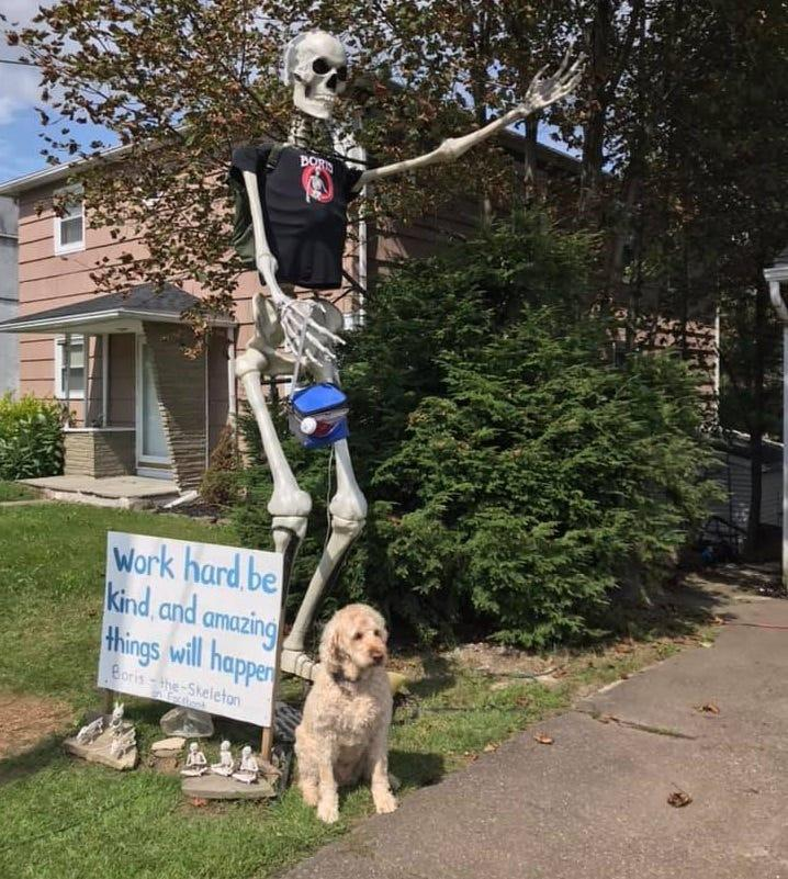 Boris the Skeleton poses with a furry fan in front of his Endwell home.
