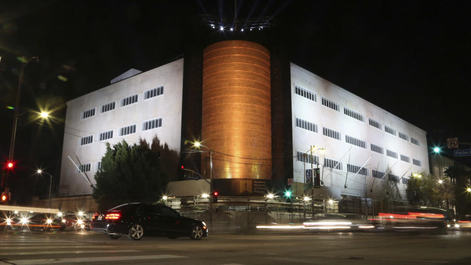 FILE - In this Dec. 4, 2018, file photo, is a view of the recently restored facade of the Saban Building from the corner of Fairfax and Wilshire Boulevard in Los Angeles. After 8 years and 13,000 donors including the likes of Barbra Streisand and Steven Spielberg, the Academy Museum of Motion Pictures has reached and exceeded its pre-fundraising goal. Academy Museum director and president Bill Kramer said Friday, Nov. 13, 2020, that the new museum has raised $388 million. (Photo by Willy Sanjuan/Invision/AP, File)