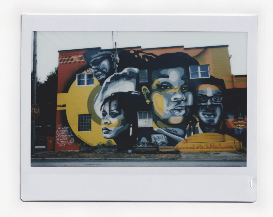 A mural of Breonna Taylor is among the painting of portraits painted on the facade of a building, Friday, July 31, 2020, in Louisville, Ky. Taylor was shot and killed by police during a botched raid at her home in Louisville on March 13, 2020. (AP Photo/Wong Maye-E)