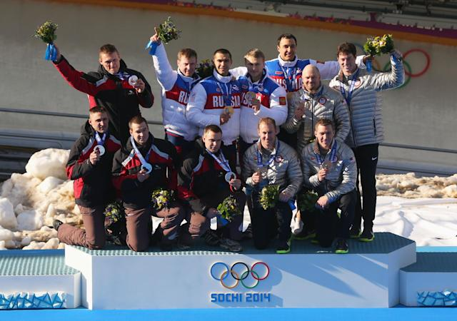 SOCHI, RUSSIA - FEBRUARY 23: Silver medalist Latvia team 1, gold medalist Russia team 1 and bronze medalist the United States team 1 on the podium during the medal ceremony for the Four-Man Bobsleigh on Day 16 of the Sochi 2014 Winter Olympics at Sliding Center Sanki on February 23, 2014 in Sochi, Russia. (Photo by Mike Ehrmann/Getty Images)