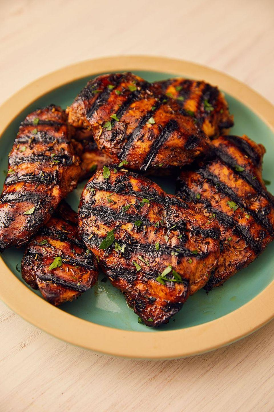 """<p>Grilled chicken breasts can be the epitome of boring. Too often they're dried out or rubbery. But when soaked in a super-quick marinade — with balsamic, brown sugar, and dried thyme — you're guaranteed deliciousness.</p><p>Get the <a href=""""https://www.delish.com/uk/cooking/recipes/a28841199/best-grilled-chicken-breast-recipe/"""" rel=""""nofollow noopener"""" target=""""_blank"""" data-ylk=""""slk:Grilled Chicken"""" class=""""link rapid-noclick-resp"""">Grilled Chicken</a> recipe.</p>"""