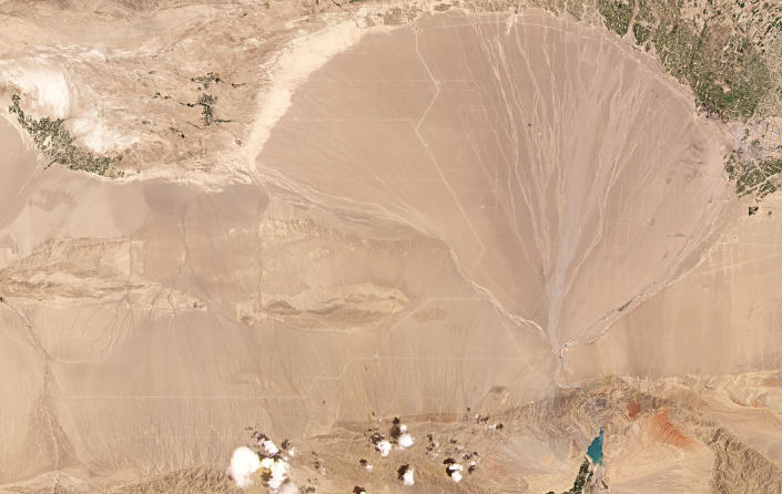 This June 4, 2021, satellite image provided by Planet Labs Inc. shows what analysts believe is a field of intercontinental ballistic missile silos near Yumen, China. The U.S. military is warning about what analysts have described as a major expansion of China's nuclear missile silo fields, at a time of heightened tension between the U.S. and China. (Planet Labs Inc. via AP)