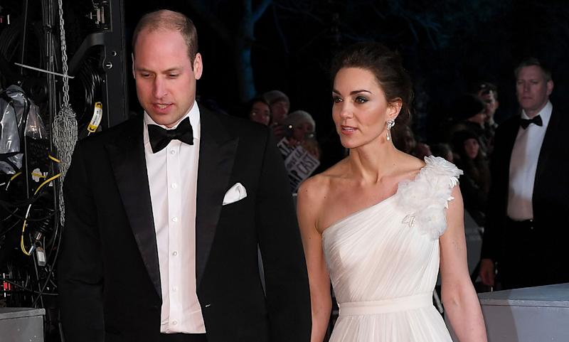 The Duke and Duchess of Cambridge enjoyed a starry night at the BAFTAs on Sunday, adding a touch of royal power to the ceremony. William, who is President of BAFTA, was joined by his wife Kate at the Royal Albert Hall. Bradley Cooper, Margot Robbie, Olivia Colman and Rami Malek were among the stars who donned their gladrags for what is dubbed the biggest night in the British film calendar.The celebrity guests started arriving at the venue from 4pm, but the red carpet went into shutdown mode when William and Kate made their grand entrance just after 6pm. The royals were welcomed by BAFTA Chief Executive Amanda Berry, who escorted the couple to their seats inside the stunning London landmark.Kate, who has attended the BAFTAs twice before, and once when she was pregnant with Prince Louis, pulled out all the stops for her glitzy night out. See the best photos...