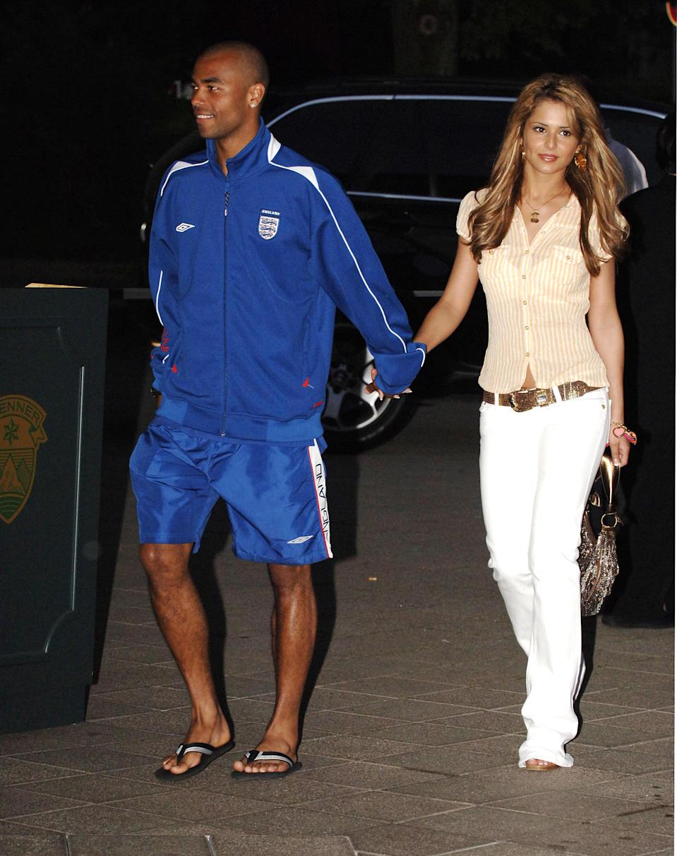 <p>Cheryl Tweedy hit the town with future-husband Ashley Cole in bootcut jeans (note: white, for added noughties style points) accessorised with a chunky charm bracelet. <em>[Photo: Getty]</em> </p>