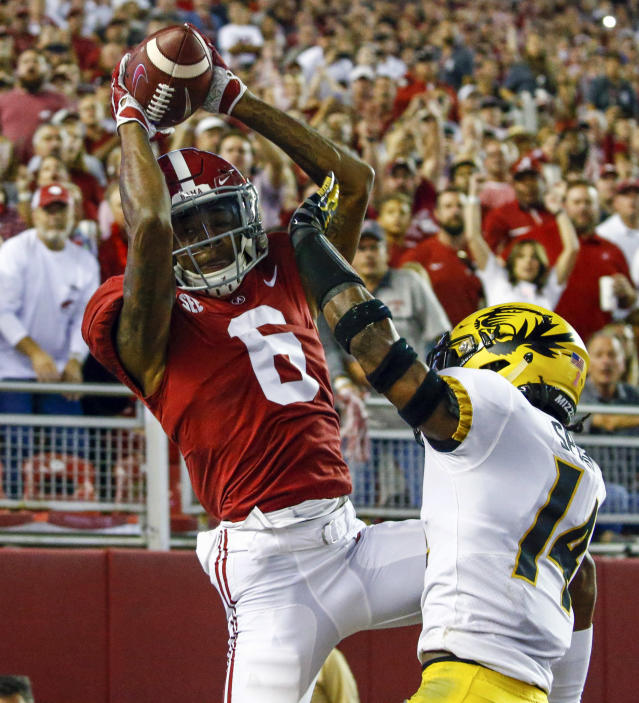Alabama wide receiver DeVonta Smith (6) catches a pass over Missouri defensive back Adam Sparks (14) in the end zone, but is ruled out of bounds during the first half of an NCAA college football game, Saturday, Oct. 13, 2018, in Tuscaloosa, Ala. (AP Photo/Butch Dill)