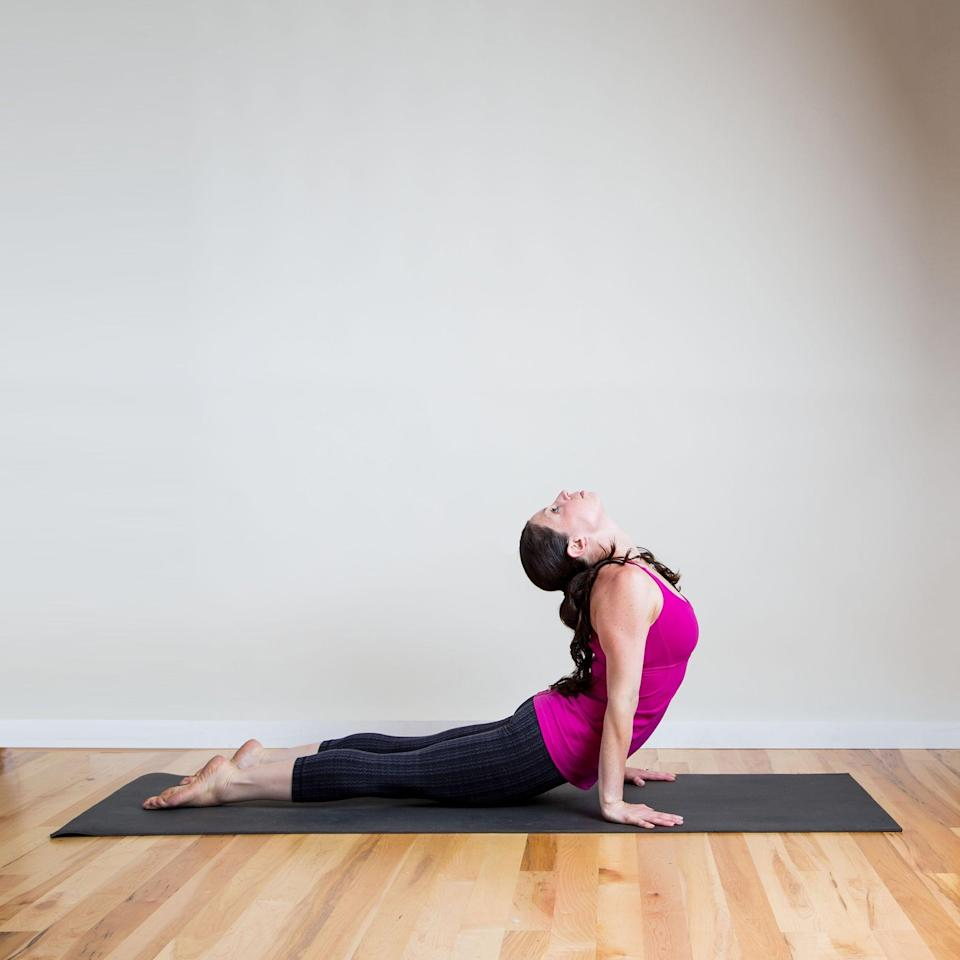 "<p><strong>Sanskrit Name:</strong> Urdhva Mukha Svanasana </p> <p><strong>English Translation:</strong> Upward Facing Dog Pose </p> <p><strong>Also Called:</strong> Up Dog </p> <ul> <li>Begin at the front of your mat in <a href=""http://www.fitsugar.com/Strike-Yoga-Pose-Mountain-Create-Your-Intention-143417"" class=""link rapid-noclick-resp"" rel=""nofollow noopener"" target=""_blank"" data-ylk=""slk:Mountain Pose"">Mountain Pose</a>. Inhale to lift your arms up and exhale to fold forward into <a href=""http://www.fitsugar.com/Strike-Yoga-Pose-Standing-Forward-Bend-152365"" class=""link rapid-noclick-resp"" rel=""nofollow noopener"" target=""_blank"" data-ylk=""slk:Standing Forward Bend"">Standing Forward Bend</a>. </li> <li>Inhale and look up with a flat back and, as you exhale, step or jump your feet back into <a href=""https://www.popsugar.com/fitness/Strike-Yoga-Pose-Four-Limbed-Staff-158710"" class=""link rapid-noclick-resp"" rel=""nofollow noopener"" target=""_blank"" data-ylk=""slk:Four-Limbed Staff Pose"">Four-Limbed Staff Pose</a>.</li> <li>Inhale a breath as you scoop your chest forward, balancing on the tops of your feet and your hands, coming into Upward Facing Dog. Lower your head back between your shoulder blades. Pull your shoulders blades down your back and hold for five breaths.</li> </ul> <p>Learn <a href=""https://www.popsugar.com/fitness/How-Do-Upward-Facing-Dog-Pose-169978"" class=""link rapid-noclick-resp"" rel=""nofollow noopener"" target=""_blank"" data-ylk=""slk:details about Upward Facing Dog Pose"">details about Upward Facing Dog Pose</a> here. </p>"