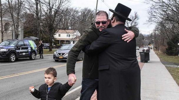 PHOTO: A member of Rabbi Chaim Rottenberg's community, right, hugs a well wisher in front of the rabbi's house on Dec. 29, 2019, in Monsey, N.Y. (Stephanie Keith/Getty Images, FILE)