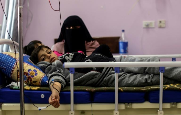 Palestinian children suffering from cancer receive treatment at a hospital in Gaza City on February 13, 2018