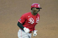 Cincinnati Reds' Aristides Aquino rounds third base on a solo home run off Minnesota Twins pitcher J.A. Happ to tie a baseball game in the fourth inning, Monday, June 21, 2021, in Minneapolis. (AP Photo/Jim Mone)