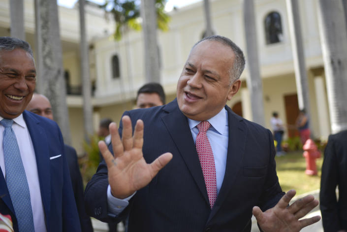 FILE- In this Jan. 8, 2020 file photo, Diosdado Cabello, president of the National Constituent Assembly, jokes with lawmakers after giving a press conference at the National Assembly in Caracas, Venezuela. Cabello has announced on Thursday, July 9, 2020, that he tested positive for COVID-19. (AP Photo/Matias Delacroix, File)