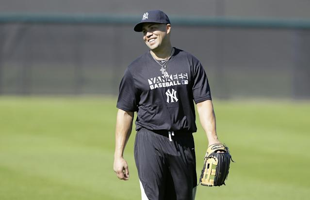New York Yankees outfielder Carlos Beltran walks in the outfield during spring training baseball practice, Monday, Feb. 17, 2014, in Tampa, Fla. (AP Photo/Charlie Neibergall)