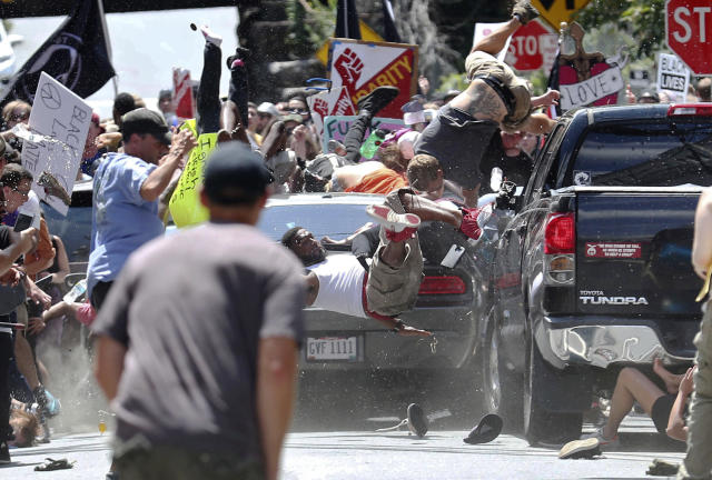 Marcus Martin seen here being flung in the air by the car. He survived the violent attack and also saved his fianceé by pushing her out of the way. Their friend Heather Heyer was killed. (Photo: AP)