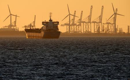 FILE PHOTO: Oil tanker is seen at sunset anchored off the Fos-Lavera oil hub near Marseille