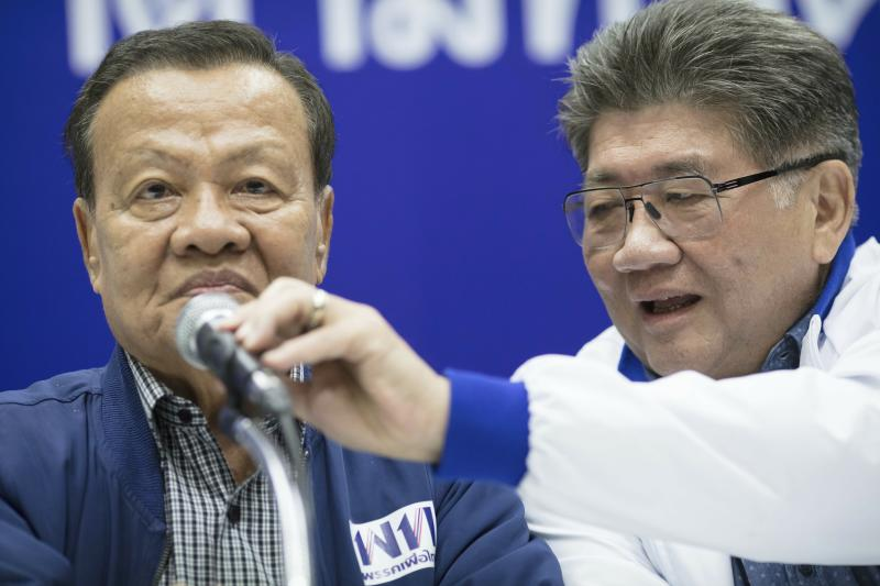 Senior leaders of Pheu Thai party, from left Virot Pao-In, leader and Phumtam Wechayachai, Secretary General hold a press conference at party head quarters in Bangkok, Thailand, Sunday, March 24, 2019. Figures from Thailand's Election Commission show a military-backed party has taken the lead in the country's first election since a 2014 coup. (AP Photo/Wason Wanichakorn)
