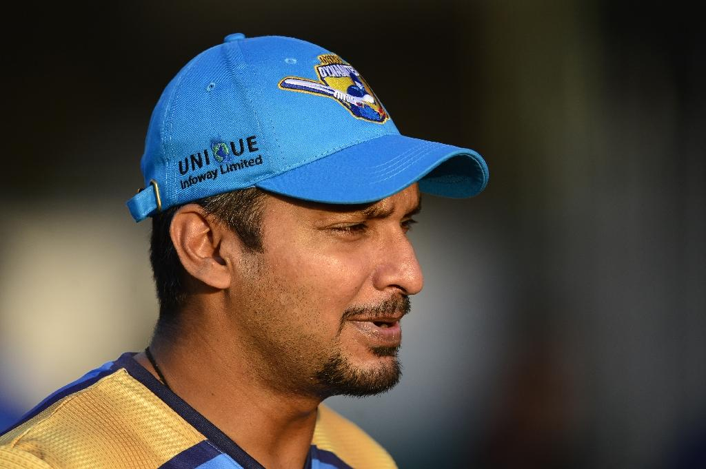 Sri Lankan Kumar Sangakkara, pictured in November 2015, says he intends to retire from first-class cricket at the end of the English summer, meaning he'll bow out with an average of just over 106 runs so far this season (AFP Photo/MUNIR UZ ZAMAN)