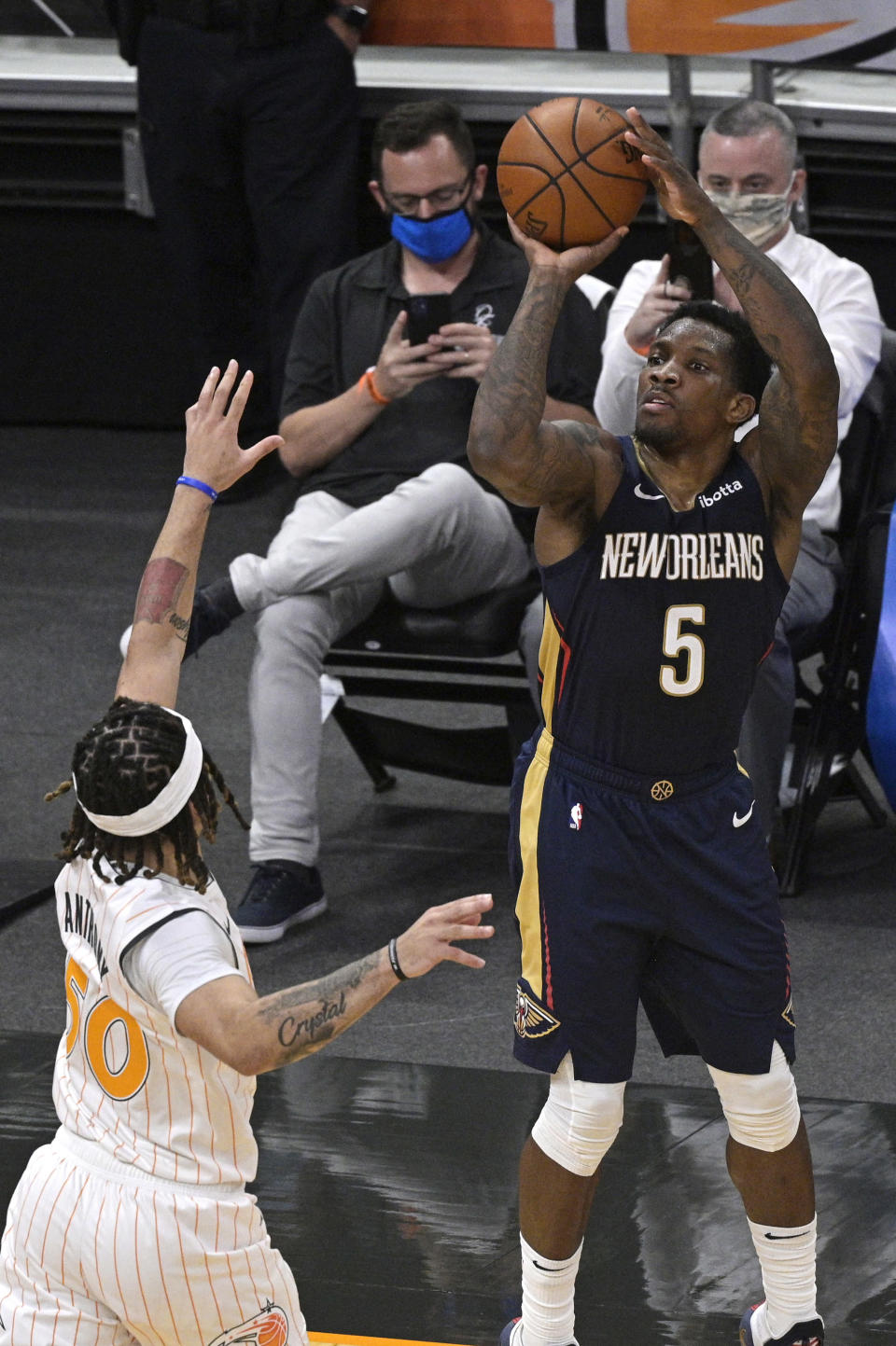 New Orleans Pelicans guard Eric Bledsoe (5) goes up for a shot in front of Orlando Magic guard Cole Anthony (50) during the second half of an NBA basketball game Thursday, April 22, 2021, in Orlando, Fla. (AP Photo/Phelan M. Ebenhack)