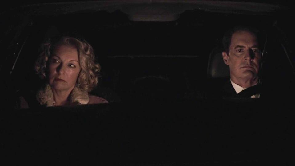 Carrie Page and Dale Cooper drive in Twin Peaks.