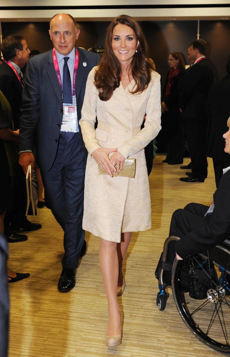 <p>Kate donned a champagne brocade coat by Day Birger et Mikkelsen for the opening ceremony of the 2012 Paralympics. She carried a gold sequinned Wilbur and Gussie clutch and completed the look with her trust L.K. Bennett pumps. </p><p><i>[Photo: PA]</i></p>