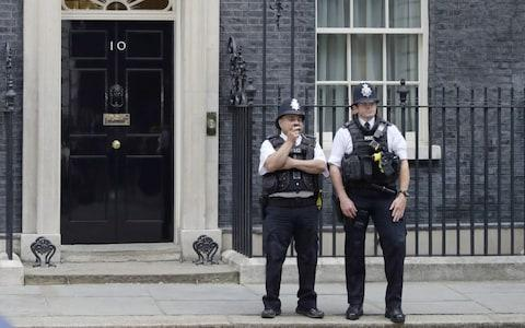 Police officers in Downing Street - Credit: Aaron Chown/PA