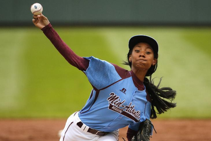 Pennsylvania's Mo'ne Davis delivers in the first inning against Tennessee during a baseball game in United States pool play at the Little League World Series tournament in South Williamsport, Pa., Friday, Aug. 15, 2014