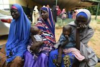 Maryam Aliyu, centre, at a displaced camp after violence forced them from their homes in Nigeria's northwest (AFP/PIUS UTOMI EKPEI)