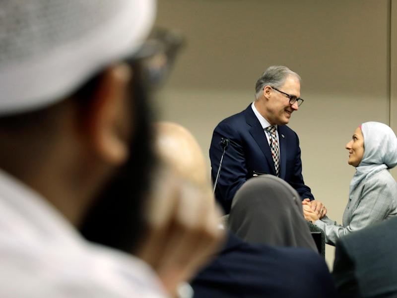 Washington Gov. Jay Inslee (D-Wash.), center, greets Muslim constituents on March 21. As Muslim political engagement has grown, politicians have shown greater interest in outreach. (Photo: ASSOCIATED PRESS/Ted S. Warren)