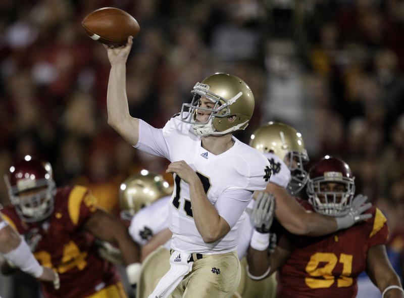 Notre Dame quarterback Tommy Rees throws a pass against Southern California during the first half of an NCAA college football game in Los Angeles, Saturday, Nov. 27, 2010. (AP Photo/Jae C. Hong)
